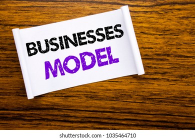 Word, writing Businesses Model. Business concept for Project For Business written on sticky note paper on wooden wood structure visible background.