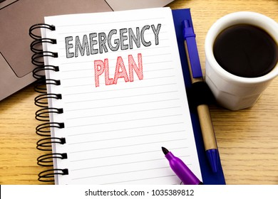 Word, writing Emergency Plan. Business concept for Disaster Protection written on notebook book on wooden background in the Office with laptop coffee