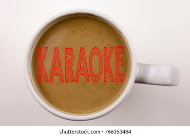 Word, writing Karaoke text in coffee in cup. Business concept for Singing Karaoke Music on white background with space. Black text with red word.