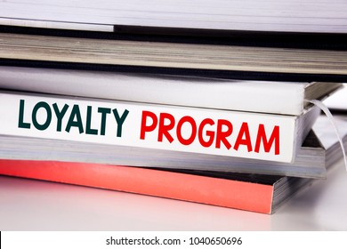 Word, writing Loyalty Program. Business concept for Marketing Concept written on the book the white background.