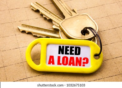 Word, writing Need A Loan Question. Business concept for Mortage Credit Written on key holder, close up.