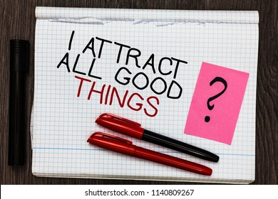 Word writing text I Attract All Good Things. Business concept for Positive attraction law Motivation Affirmation Color pen on written notepad with question mark black marker on woody deck.