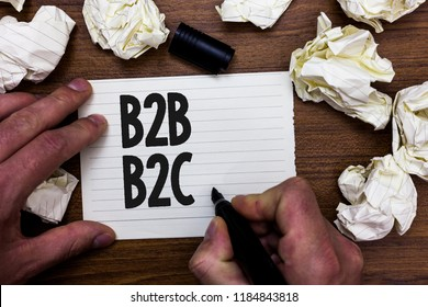 Word writing text B2B B2C. Business concept for two types for sending emails to other people Outlook accounts Man holding marker notebook page crumpled papers several tries mistakes.