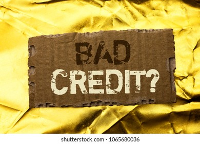 Word writing text Bad Credit Question. Business concept for Low Credit Finance Economic Budget Asking Questionaire written on tear Cardboard Piece on the Golden textured background.