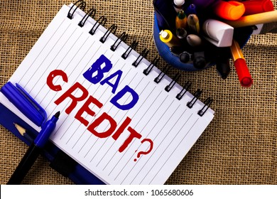 Word writing text Bad Credit Question. Business concept for Low Credit Finance Economic Budget Asking Questionaire written on Notebook Book on the jute background Pencils next to it.