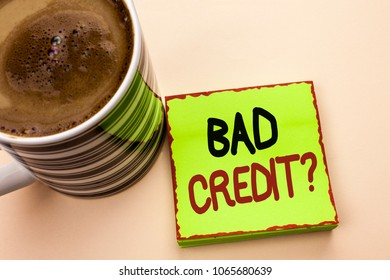 Word writing text Bad Credit Question. Business concept for Low Credit Finance Economic Budget Asking Questionaire written on Green Sticky Note Paper on the plain background Coffee Cup next to it.