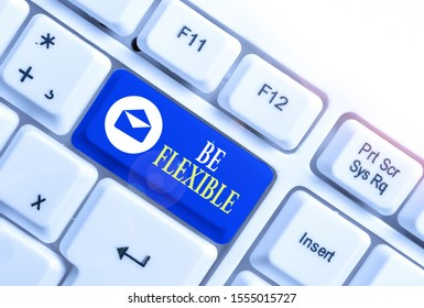Word writing text Be Flexible. Business concept for able to be easily modified to respond to altered circumstances White pc keyboard with empty note paper above white background key copy space.