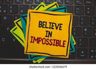 Word writing text Believe In Impossible. Business concept for You can do it everything is possible Work hard Multiple colour sticky border cards computer keyboard text send message.