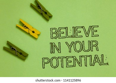Word writing text Believe In Your Potential. Business concept for Have self-confidence motiavate inspire yourself Outline words green middle yellow paper clip on olive color ground.