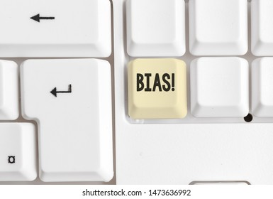 Word writing text Bias. Business concept for inclination or prejudice for or against one demonstrating group White pc keyboard with empty note paper above white background key copy space.