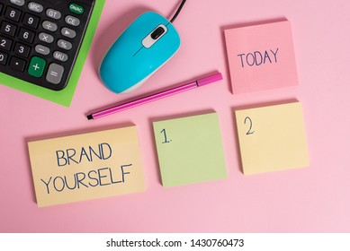 Word writing text Brand Yourself. Business concept for Develop a unique professional identity Personal product Blank notepads wire mouse calculator sheet marker pen colored background.