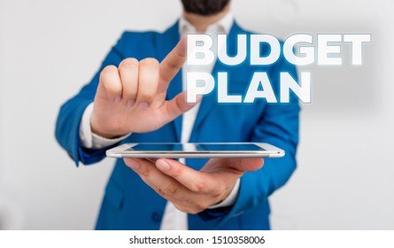 Word writing text Budget Plan. Business concept for financial schedule for a defined period of time usually year Businessman with pointing finger in front of him.