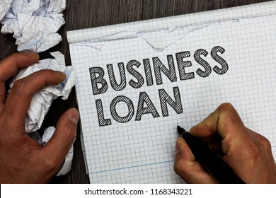 Word writing text Business Loan. Business concept for Credit Mortgage Financial Assistance Cash Advances Debt Man holding marker notebook crumpled papers several tries mistakes made.