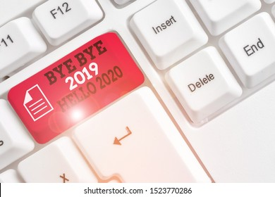 Word writing text Bye Bye 2019 Hello 2020. Business concept for Starting new year Motivational message 2019 is over White pc keyboard with empty note paper above white background key copy space.