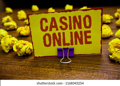 Word writing text Casino Online. Business concept for Computer Poker Game Gamble Royal Bet Lotto High Stakes Clip holding yellow paper note crumpled papers several tries mistakes.