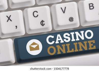 Word writing text Casino Online. Business concept for Computer Poker Game Gamble Royal Bet Lotto High Stakes White pc keyboard with empty note paper above white background key copy space.