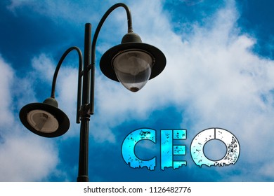 Word writing text Ceo. Business concept for Chief Executive Officer Head Boss Chairperson Chairman Controller Light post blue cloudy clouds sky ideas message enlighten reflections.