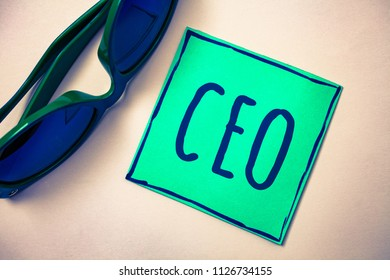 Word writing text Ceo. Business concept for Chief Executive Officer Head Boss Chairperson Chairman Controller Green paper beige background sunglasses ideas messages feelings thoughts.