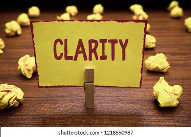 Word writing text Clarity. Business concept for Being coherent intelligible Understandable Clear ideas Precision Clothespin holding yellow paper note crumpled papers several tries mistakes.