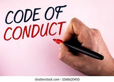 Word writing text Code Of Conduct. Business concept for Follow principles and standards for business integrity written by Man holding Marker in Hand plain background.