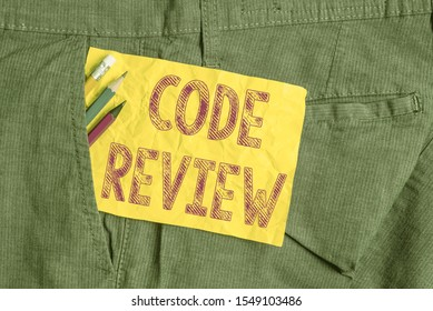 Word writing text Code Review. Business concept for single most effective technique for identifying security flaws Writing equipment and yellow note paper inside pocket of man work trousers.
