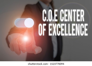 Word writing text Coe Center Of Excellence. Business concept for being alpha leader in your position Achieve Woman wear formal work suit presenting presentation using smart device.