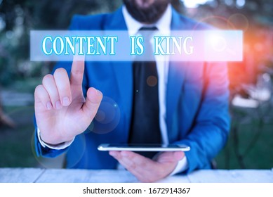 Word writing text Content Is King. Business concept for marketing focused growing visibility non paid search results.