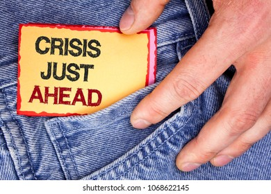 Word writing text Crisis Just Ahead. Business concept for Foresee failure take right action before it is late written Sticky Note Paper holding by man the Jeans background.