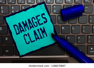 Word writing text Damages Claim. Business concept for Demand Compensation Litigate Insurance File Suit Turquoise paper keyboard Inspiration communicate idea messages blue markers.