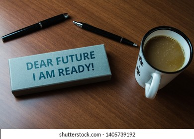 Word writing text Dear Future I Am Ready. Business concept for suitable state for action or situation being fully prepared Upper close view two ball point pens case set coffee cup lying wooden table.