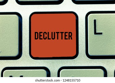 Word writing text Declutter. Business concept for remove unnecessary items from untidy or overcrowded place Keyboard key Intention to create computer message, pressing keypad idea.