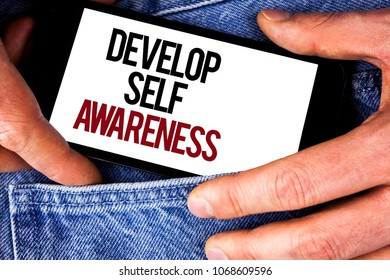 Word writing text Develop Self Awareness. Business concept for What you think you become motivate and grow written Mobile phone holding by man the Jeans background.