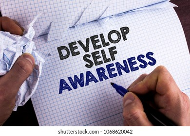 Word writing text Develop Self Awareness. Business concept for What you think you become motivate and grow written by Man Tear Nootbook Book holding Marker wooden background.