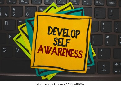 Word writing text Develop Self Awareness. Business concept for increase conscious knowledge of own character Multiple colour sticky border cards computer keyboard text send message.