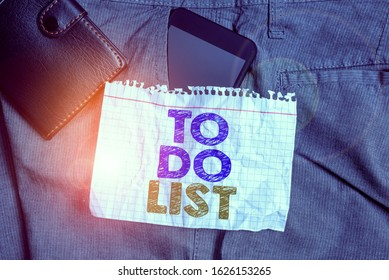 Word writing text To Do List. Business concept for A structure that usualy made in paper contining task of yours Smartphone device inside trousers front pocket with wallet and note paper.