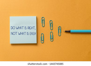 Word writing text Do What Is Right Not What Is Easy. Business concept for willing to stand up for what is right Colored blank sticky note clips binders gathered pen trendy cool background.