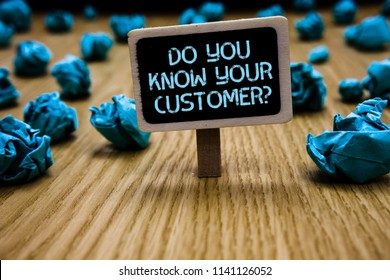 Word writing text Do You Know Your Customer question. Business concept for Have into account client likes opinion Paperclip hold black paperboard with text blue paper lobs on wooden floor.