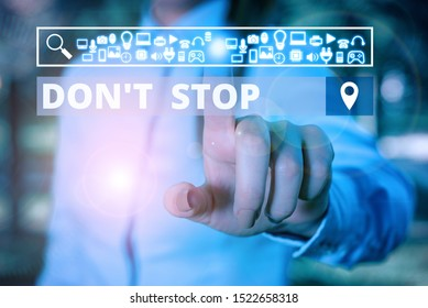 Word writing text Don T Stop. Business concept for Continue what had been doing without rendering a delay Woman wear formal work suit presenting presentation using smart device.