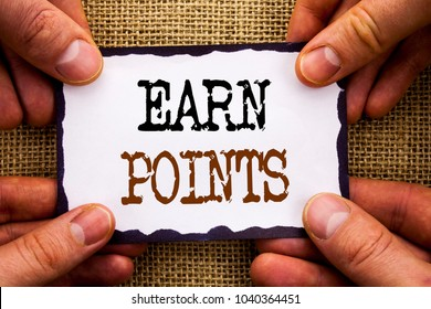 Word, writing, text  Earn Points. Conceptual photo Loyalty Reward Benefit Program For Earning Customer Point written Sticky Note Paper Holding Hand with Finger.