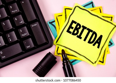 Word writing text Ebitda. Business concept for Earnings before tax is measured to evaluate company performance written on Sticky Note paper on plain background Marker and Keyboard next to it.