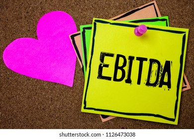 Word writing text Ebitda. Business concept for Earnings Before Interest Taxes Depreciation Amortization Abbreviation Cork background paper ideas messages pink heart love lovely inspiration.