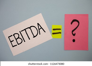 Word writing text Ebitda. Business concept for Earnings Before Interest Taxes Depreciation Amortization Abbreviation Ideas messages equal sign question mark doubts considerations thoughts.