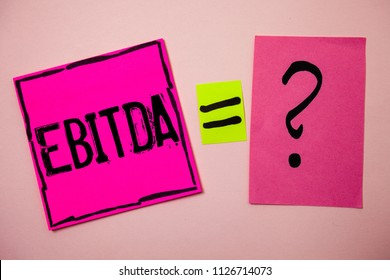 Word writing text Ebitda. Business concept for Earnings Before Interest Taxes Depreciation Amortization Abbreviation Ideas messages doubts equal sign question marks questions inspirational.