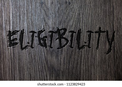 Word writing text Eligibility. Business concept for State of having the right for doing or obtain something Proper Wooden wood background black engraved letters words ideas messages concepts.