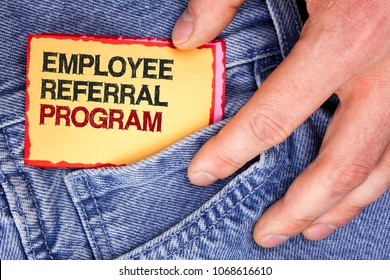 Word writing text Employee Referral Program. Business concept for Recommend right jobseeker share vacant job post written Sticky Note Paper holding by man the Jeans background.