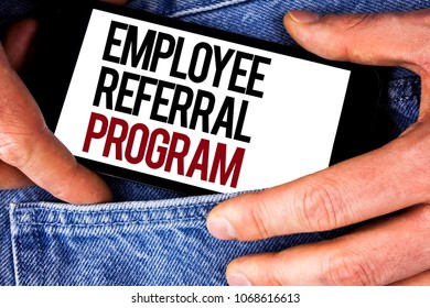 Word writing text Employee Referral Program. Business concept for Recommend right jobseeker share vacant job post written Mobile phone holding by man the Jeans background.