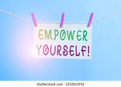 Word writing text Empower Yourself. Business concept for taking control of our life setting goals and making choices Clothesline clothespin rectangle shaped paper reminder white wood desk.
