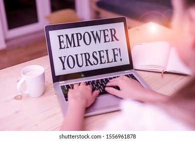 Word writing text Empower Yourself. Business concept for taking control of our life setting goals and making choices woman laptop computer smartphone mug office supplies technological devices.