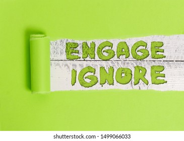 Word writing text Engage Ignore. Business concept for Silent Treatment Manipulative Punishment Sulking Shunning.