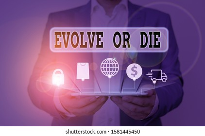 Word writing text Evolve Or Die. Business concept for Necessity of change grow adapt to continue living Survival.